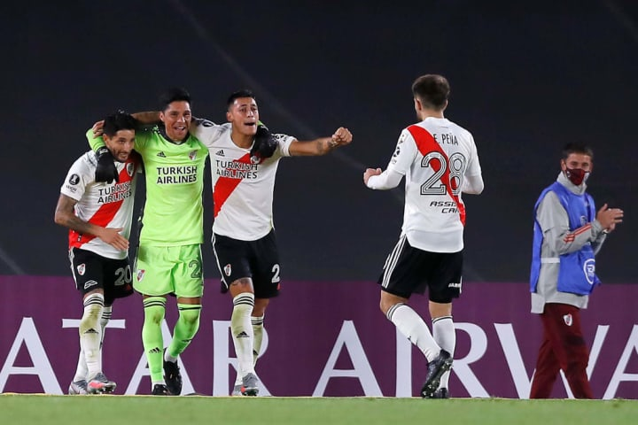 Enzo Perez celebrates with his teammates