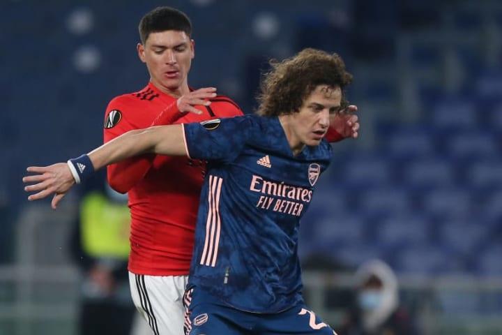 David Luiz holds off his man