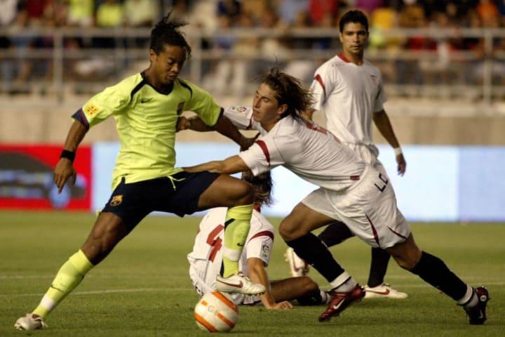 Sevilla's player Sergio Ramos (R) vies w