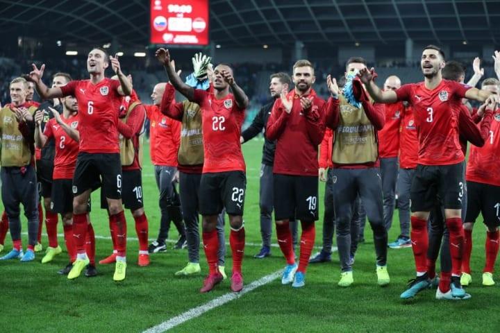 The Austria team celebrate their Euro 2020 qualifying win over Slovenia