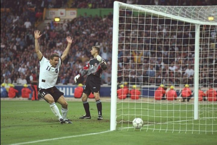 Stefan Kuntz of Germany (number 11) celebrates Oliver Bierhoff's winning goal