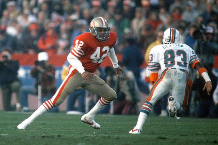 Former 49ers defensive back Ronnie Lott plays against the Miami Dolphins in the Super Bowl.
