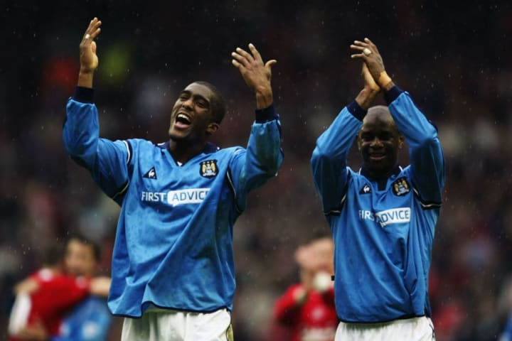 Sylvain Distin and David Sommeil of Manchester City celebrate victory