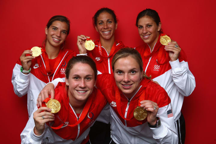 Lloyd (top right) won Olympic gold for the first time in 2008