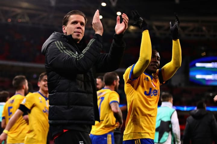 Szczesny takes to the field to salute the travelling Juventus fans after his side knocked his old north London rivals out of the Champions League