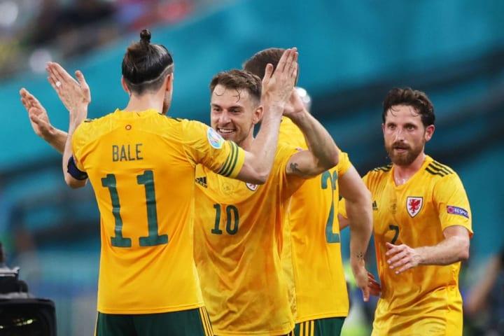Gareth Bale and Aaron Ramsey celebrate the Juventus man's goal