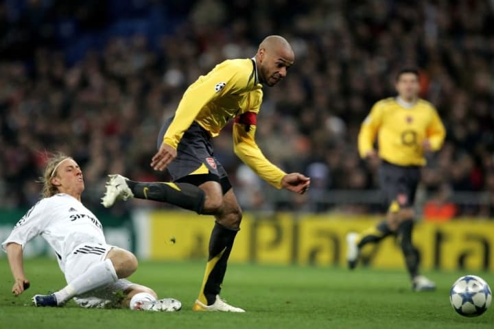 Henry runs clear of Guti en route to goal
