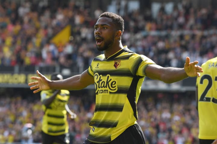 Emmanuel Dennis found the net on his competitive debut for Watford against Aston Villa