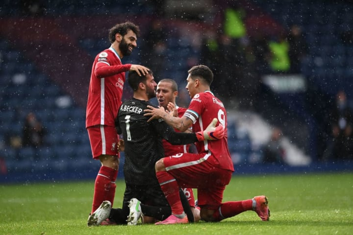 Alisson celebrates his goal at West Brom