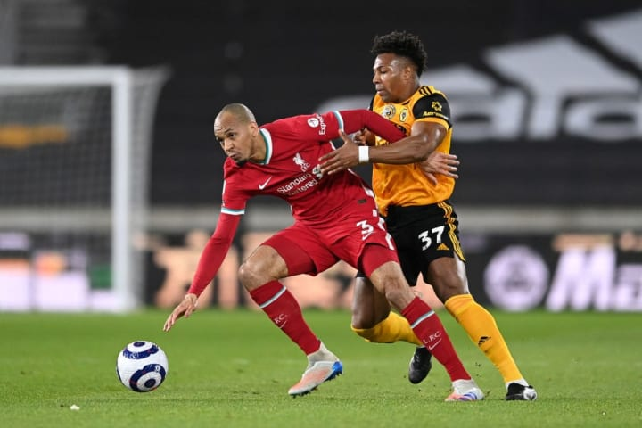 Liverpool's Fabinho holds off Wolves' Adama Traore