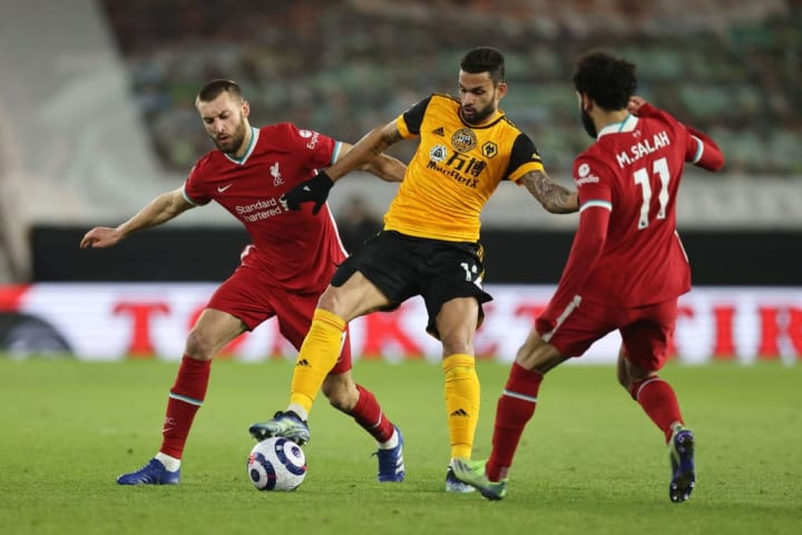 Liverpool's Nat Phillips challenges Wolves' Willian Jose
