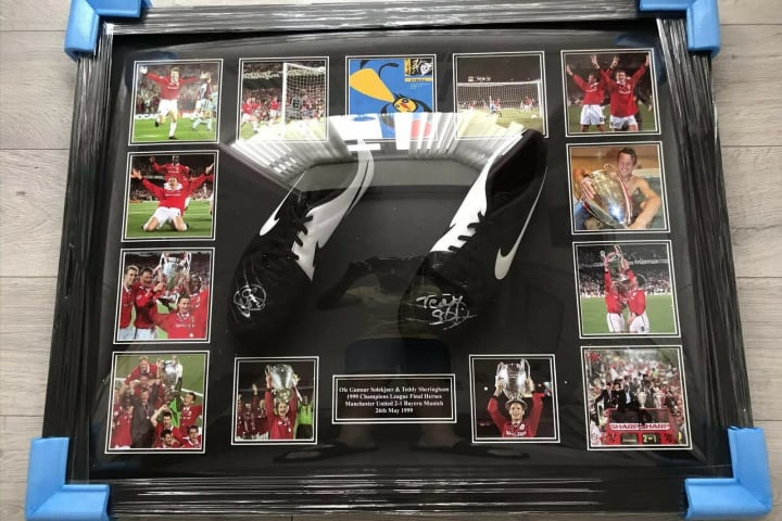 Football boots signed by Ole Gunnar Solskjaer and Teddy Sheringham