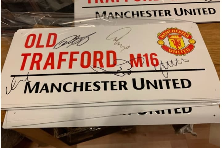 Old Trafford road sign with Class of '92 signatures