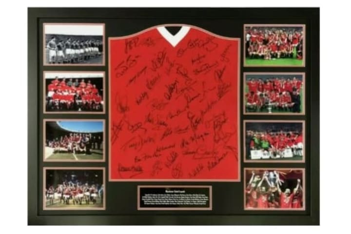 Manchester United shirt signed by 33 ex-players