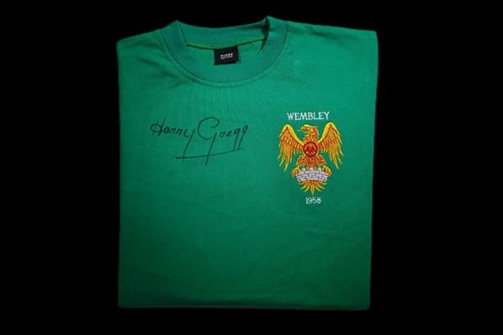 Replica 1958 goalkeeper shirt signed by Harry Gregg