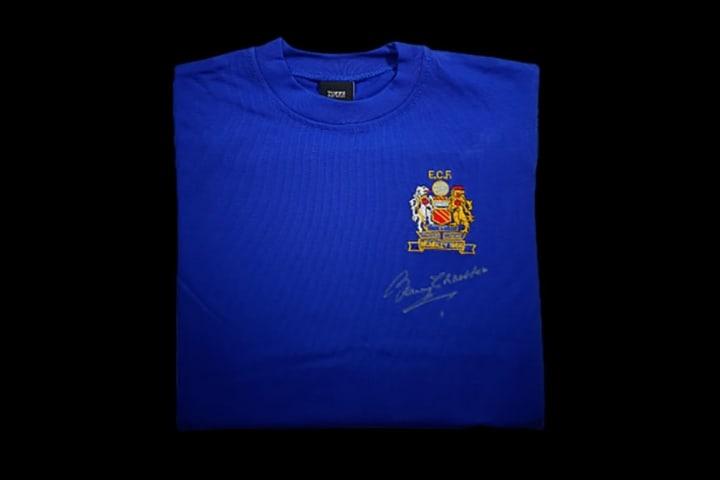 1968 replica shirt signed by Bobby Charlton