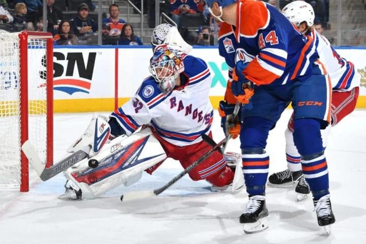EDMONTON, AB - NOVEMBER 13: Zack Kassian #44 of the Edmonton Oilers takes a shot on Antti Raanta #32 of the New York Rangers on November 13, 2016