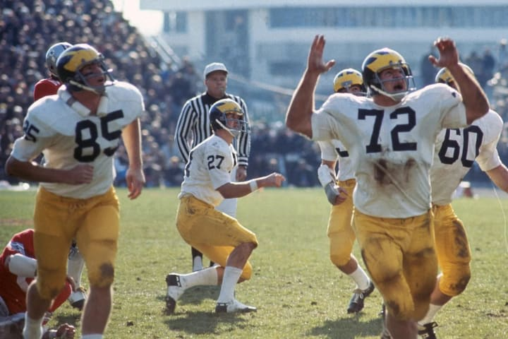 Michigan's Paul Seymour (85), QB Don Moorhead (27) and Dan Dierdorf (72) upset after losing against Ohio State in 1970.