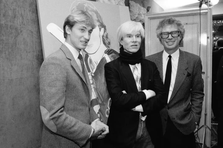 Edmonton Oilers center Wayne Gretzky, left, poses with Andy Warhol and Canadian Ambassador Ken Taylor, after Warhol unveiled his portrait of Gretzky a