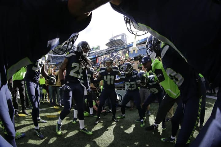 Members of the Seattle Seahawks huddle up before an NFL football game against the San Francisco 49ers, Sunday, Sept. 25, 2016, in Seattle. The Seahawk