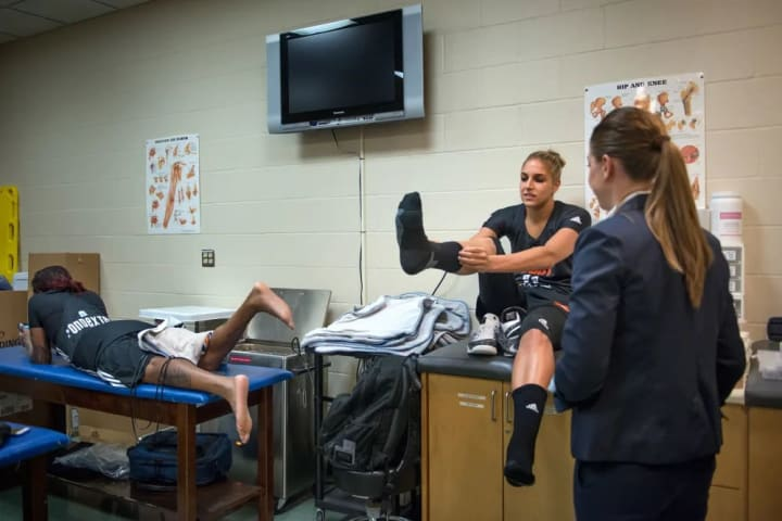 12:32PM Cappie Pondexter, my Chicago Sky and Eastern Conference teammate, and I get our ankles taped.