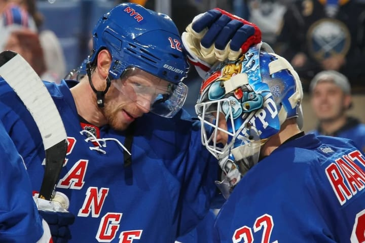 BUFFALO, NY - MARCH 08: Eric Staal #12 and Antti Raanta #32 of the New York Rangers celebrate their victory over the Buffalo Sabres during an NHL game