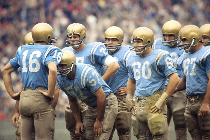 UCLA quarterback Gary Beban calls a play in the huddle against USC in 1965.