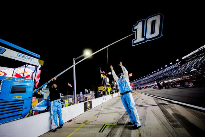 Before the race, my pit crew guys work to get the No. 10 sign in place so I know where to stop when I come in for pit stops.