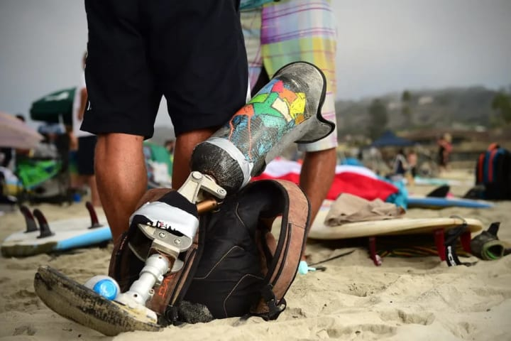 A prosthetic leg lays on the beach during the finals.