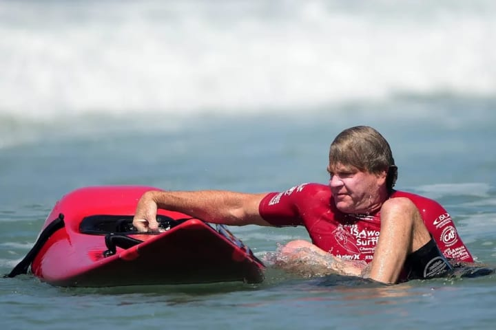 Jeff Munson of the USA works to get back on his board.