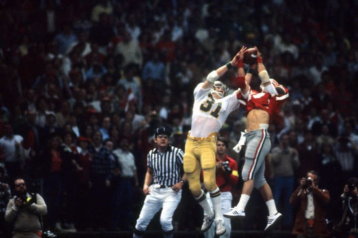 Georgia's Scott Woerner makes an interception against Notre Dame's Pete Holohan at the Louisiana Superdome during the 1981 Sugar Bowl.