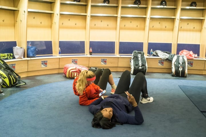 Serena and me hanging in the locker room before the match. We're always on our phones.