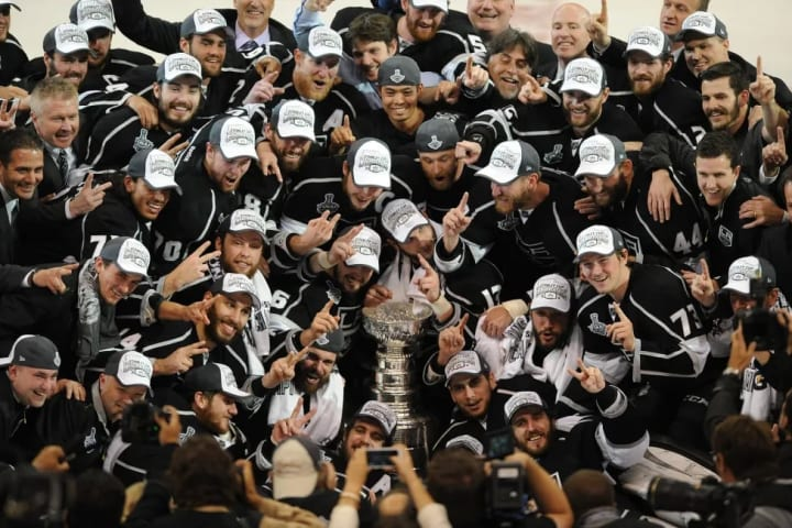 06 Jun. 2014: The Los Angels Kings gather around the Stanley Cup after defeating the New York Rangers 3 to 2 in game 5 of the Stanley Cup Final to bec