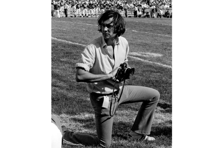 Walter Iooss Jr. on the sidelines during USC versus Nebraska game at Memorial Stadium in 1969.