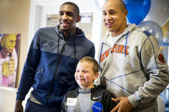 Haiden gets his picture taken with Starks and Galloway before heading off to basketball practice. Haiden's Wish is to meet LeBron James.