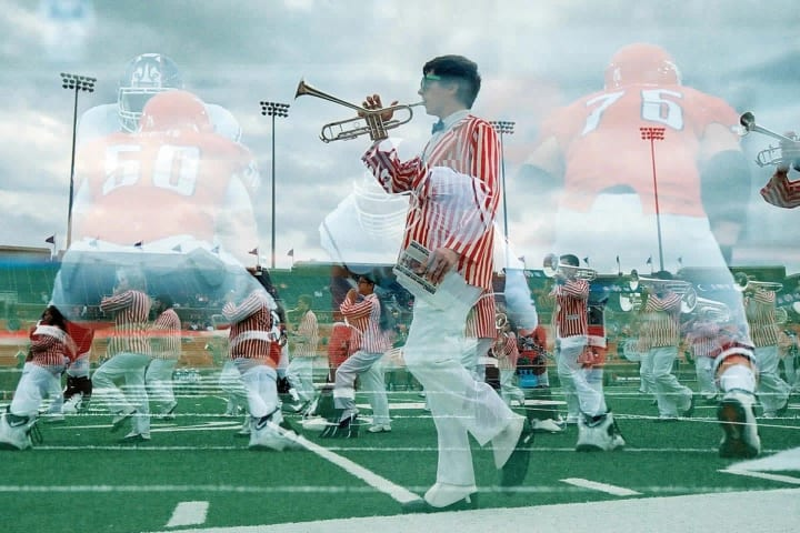 A member of the SMU marching band takes the field for the halftime show during an NCAA football game between the SMU Mustangs and UConn Huskies on Nov