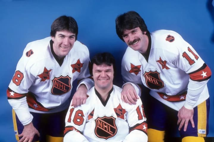 HARTFORD, CT - JANUARY 14: Dave Taylor #18, Marcel Dionne #16 and Charlie Simmer #11 of the Wales Conference and Los Angeles Kings pose for a portrait