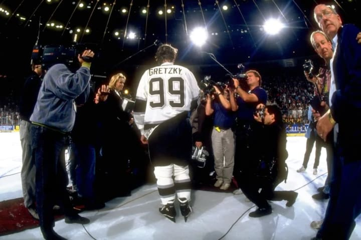 Hockey: Rear view of Los Angeles Kings Wayne Gretzky (99) with wife Janet and photographers and camermen during on ice ceremony after scoring 802nd re