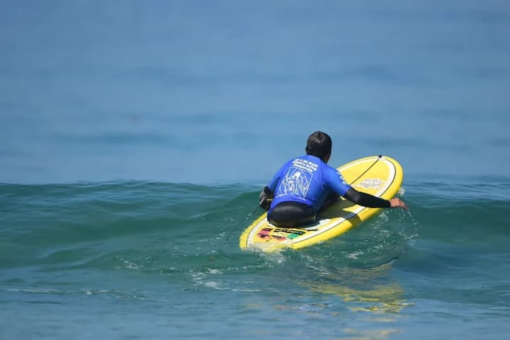 Elias Valencia of Chile paddling out.