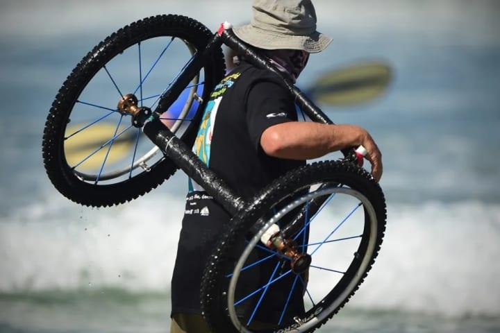 Surfer/surfboard valet on the beach.