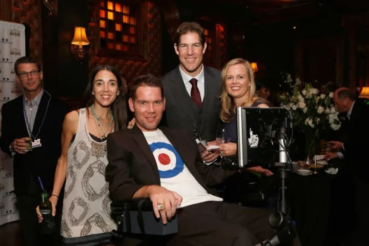 NEW ORLEANS, LA - FEBRUARY 02: (L-R) Michel Gleason, Steve Gleason, Scott Fujita and Jaclyn Fujita attend The Giving Back Fund's 4th Annual Big Game B