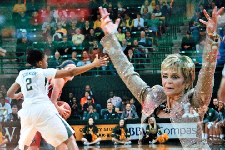 Baylor head coach Kim Mulkey raises her hands from the bench as she communicates with her defense against Ole Miss on December 18, 2013 at the Ferrell