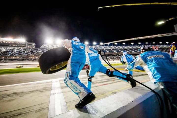 My Nature's Bakery team jumps into action on pit road.