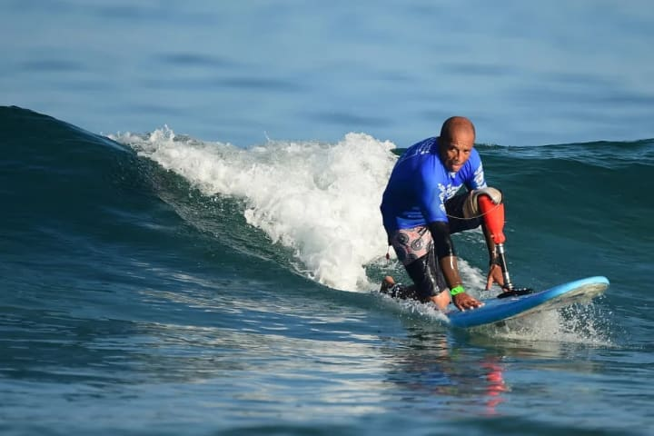 Laurent Marouf, France, surfs in a modified upright stance.