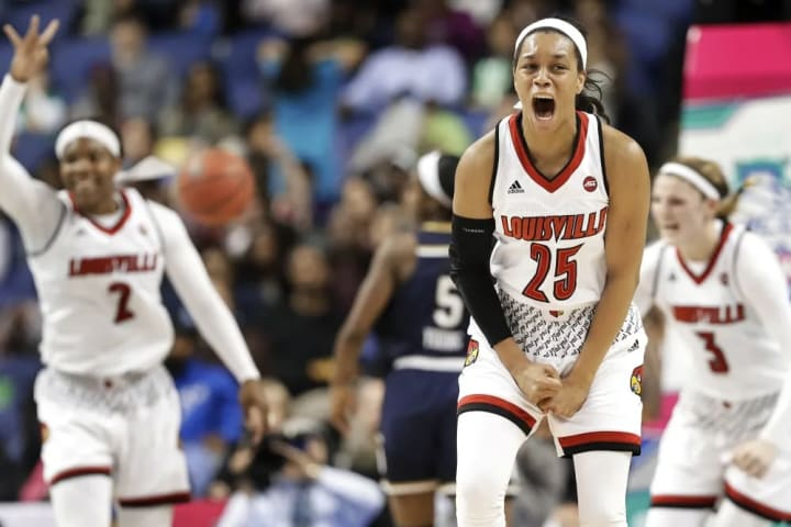 Louisville's Asia Durr (25) celebrates after making a basket against Notre Dame late in the second half of an NCAA college basketball game in the cham