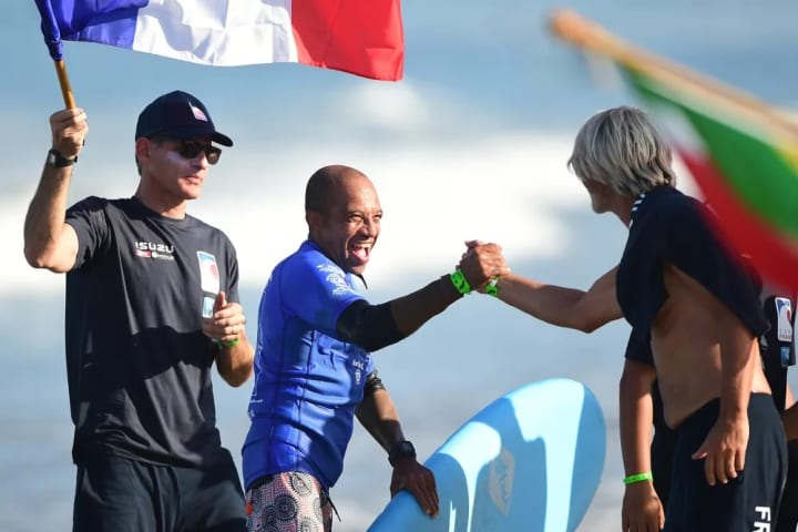 Marouf, celebrates his ride with teammates.