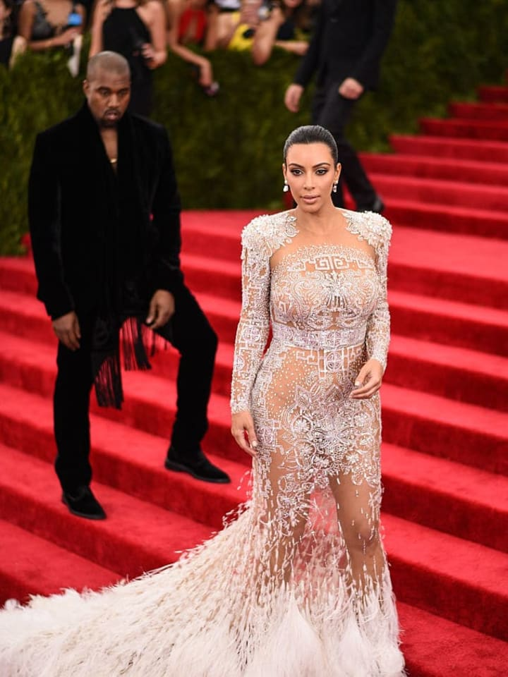 """NEW YORK, NY - MAY 11:  Kim Kardashian and Kanye West attend the """"China: Through The Looking Glass"""" Costume Institute Benefit Gala at the Metropolitan Museum of Art on May 4, 2015 in New York City.  (Photo by Andrew H. Walker/Getty Images for Variety)"""