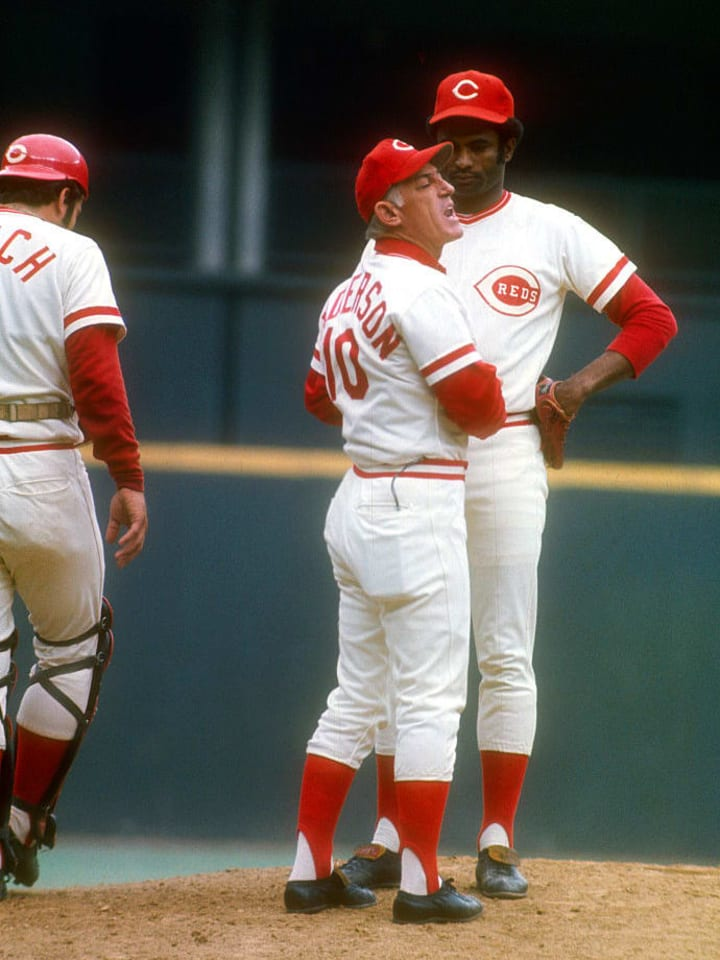 CINCINNATI, OH - OCTOBER 15: Manager Sparky Anders #10 of the Cincinnati Reds stands on the mound talking with pitcher Pedro Borbon #34 against the Boston Red Sox during Game Four of the 1975 World Series October 15, 1975 at Riverfront Stadium in Cincinnati, Ohio. The Reds won the series 4-3. (Photo by Focus on Sport/Getty Images)