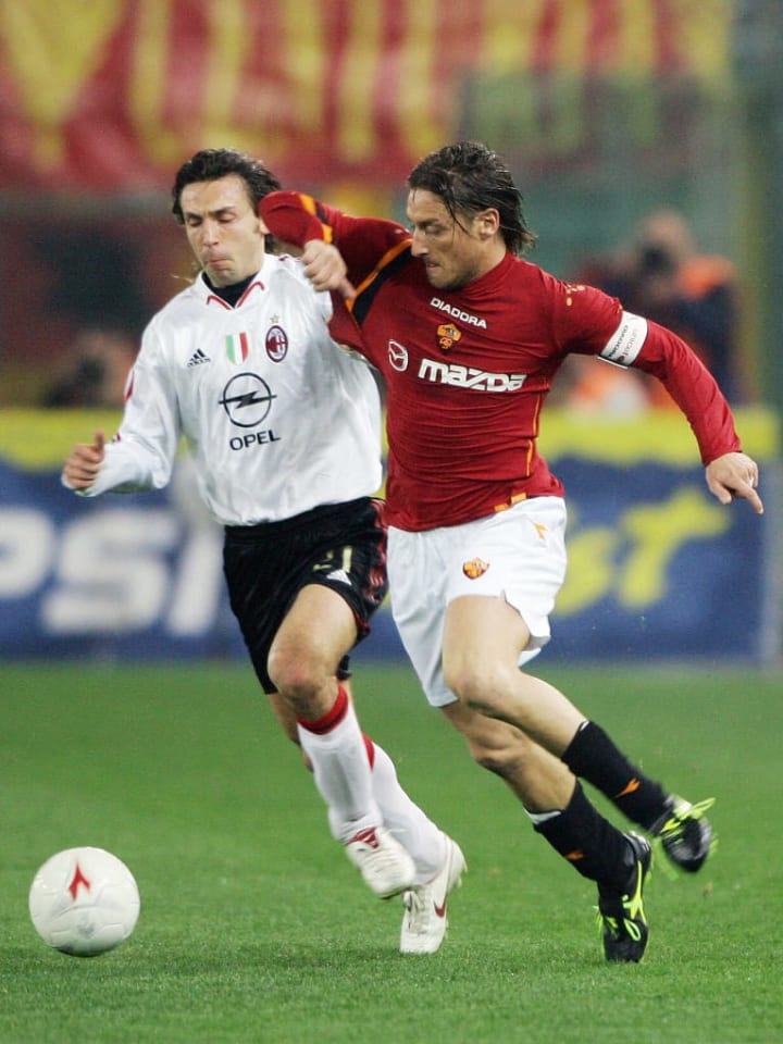 A young(er) Pirlo and Totti in action for Milan and AS Roma