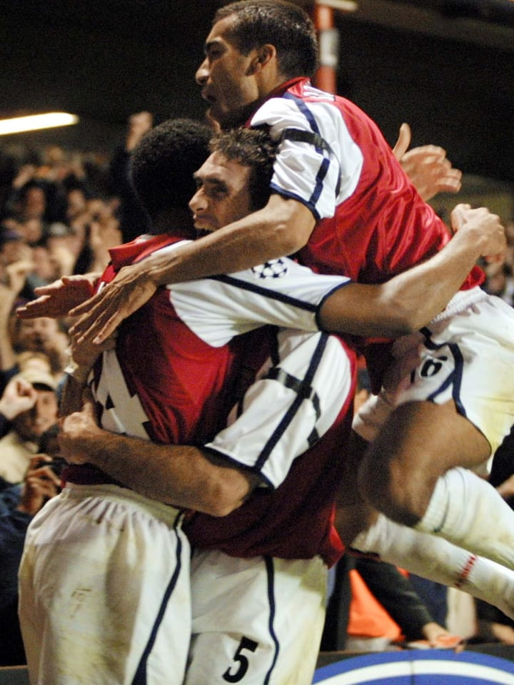 Thierry Henry and Martin Keown celebrate the Frenchman's goal against Mallorca
